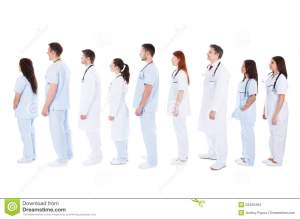large-group-medical-staff-standing-queue-diverse-white-uniforms-isolated-white-52420494